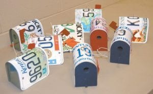 This assortment of birdhouses made in part with old license plates is on display in the offices of Letcher County Clerk Winston Meade. The houses were built by Meade's father-in-law, Arnold Lee Watson, to help raise money for the Veterans Program Trust Fund. (Eagle photo)