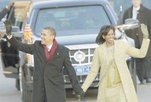 President Barack Obama walked down Pennsylvania Avenue with his wife Michelle Obama on their way to the White House on Tuesday. (AP Photo)
