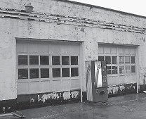 Fire trucks are stored in this old auto repair garage nearby the fire station.
