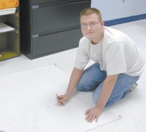 Zack Yaden at work drawing his winning entry.