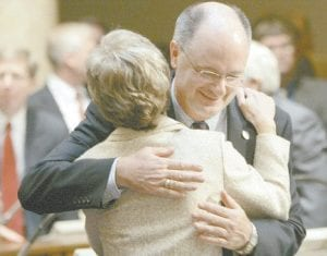 New Sen. John Schickel, R-Union, was hugged by Senate President Pro Tem Katie Stine, R-Southgate, after being sworn into office earlier this month. (AP Photo/Ed Reinke)