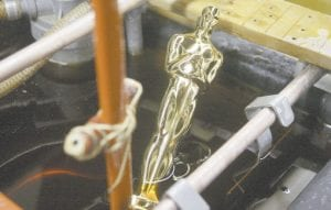 Oscar #3453 was pulled from the final plating process that coats the statue with 24 karat gold at R.S. Owens & Company on Monday (Jan. 26) in Chicago. (AP Photo/M. Spencer Green)