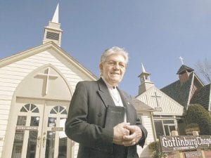 The Reverend Ed Taylor stood outside the Gatlinburg Chapel on January 31 in Ga tlinburg, Tenn., where he has performed ceremonies for 30 years. (AP Photo)