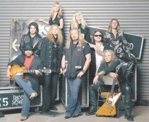 Lynyrd Skynyrd keyboard player Billy Powell, pictured third from right wearing glasses) in this promotional photo, died at his Florida home on Jan. 28, apparently of heart failure. (AP Photo/Universal Records)