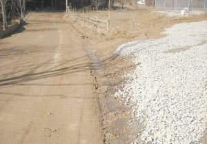A MUDDY MESS — A state highway official says workers for Kinzer Drilling of Floyd County have been working this week to try to clean up this eyesore on Kentucky Highway 2035 at Little Cowan. The mud was carried onto the road by heavy trucks going to and from a natural gas drilling site near the base of Pine Mountain. (Photo submitted)