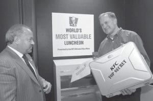Kentucky Fried Chicken corporate security expert Bo Dietl, left, watched as Roger Eaton, president of KFC USA, placed Colonel Harland Sanders' handwritten Original Recipe of 11 herbs and spices into KFC headquarters' newly modernized and remodeled vault this week in Louisville. (AP Photo)