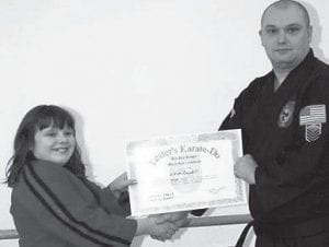 BLACK BELT — Vivian Caudill, 10-year-old daughter of Doyle and Patricia Caudill of Number Two Bottom, Burdine, received her black belt in Ryu Kyu Kempo Karate from the Lester's Karate Do School. She is the youngest student at the karate school ever promoted to black belt, said William Lester. She is a fourth-grade student at Burdine Elementary School.