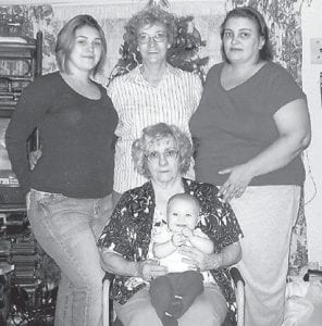 FIVE GENERATIONS — Pictured are five generations of Geneva Adams's family. Seated is Geneva Adams holding Allie Keel, her great-great-granddaughter. Behind them are (left to right) Kimberly Keel, Wanda Tolliver, and Sherry Keel.