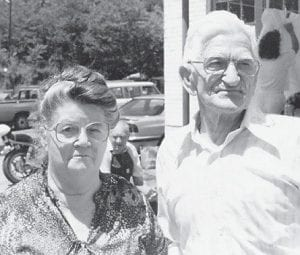 MARLOWE REUNION — The late Bill Howard, father of Whitesburg correspondent Oma Hatton, is pictured at a Marlowe reunion in the 1980s. He was born on March 9, 1907 and would have been 102 years old this year. With him is 'the love of his life', his wife, the late Cindy Howard. In the background is the late John Brown of Dry Fork.