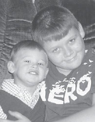 BROTHERS — Dakota Johnson will turn two years old on Feb. 27. He is pictured with his brother, Austin. They are the sons of Rook and Colleen Johnson. Their grandparents are Lige and Mary Johnson and Johnny and Brenda Mullins, all of Jenkins, and Maxie Mullins of North Carolina.