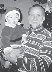BIRTHDAYS — William Benjamin Cornett celebrated his first birthday Feb. 15. He is the son of Ben and Ashley Cornett of Cumberland. His grandparents are Lonnie and Deborah Pack of Kingscreek, Dave and Dart Turner of Cumberland, and David and Mary Cornett of Cumberland. He is pictured with his grandfather, Lonnie Wayne Pack, who has a birthday on March 29.