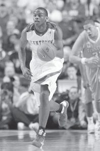 Kentucky guard Darius Miller brought the ball up the court against Tennessee in Lexington on Feb. 21. Miller helped lead the Wildcats to a win. (AP Photo/Ed Reinke)