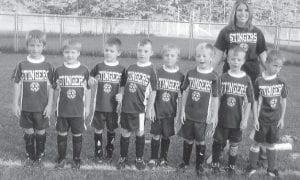STINGERS — The Stingers are raring to go for this year's season of soccer and are awesome and powerful, says coach McKenzie Williams. Pictured are Tod Looney, Bo Meade, Creed Warf, Dylan Flich, Keylan Vanover, Zack Hensley, Kane Wampler, Parker Williams, and coach Williams.