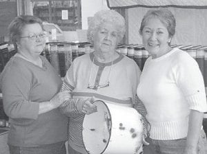 RECOVERED — Bessie Shepherd (left) and Rissie Mullins (right) recently made a special presentation of a found object to Georgia B. Helton of East Jenkins.