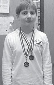 MEDAL WINNER — Jacob Craiger, a seventh-grade student at Arlie Boggs Elementary School, won medals in storytelling and radio broadcasting at the Regional Junior High School Speech League Tournament.