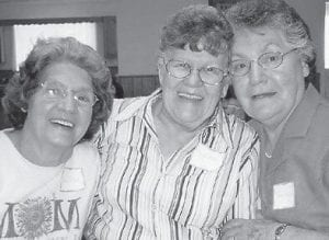 PENNINGTON REUNION — Dorthy Tacket, the late Wanda (Stidham) Miller, and Pearl Pennington Noble are pictured at the Pennington family reunion held in the Millstone Church kitchen in 2007. Wanda (Stidham) Miller died February 21 of this year.