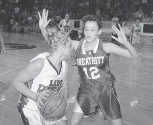 High school stars Sharaye Kincer of Letcher County Central, left, and Kendall Noble, of Breathitt County, met in the championship game of the girls' 14th Regional Tournament last Friday. The Lady Bobcats won the title and advanced to the girls' Sweet Sixteen in Bowling Green this week. (Photo by Chris Anderson)