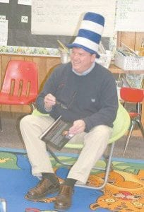 READING DR. SEUSS — Wearing the unmistakable head gear of Dr. Seuss's 'The Cat in the Hat', Letcher County Judge/Executive Jim Ward read from Dr. Seuss's children's books to students at Martha Jane Potter Elementary School in a program celebrating the noted author's birthday.