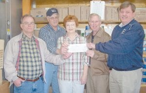 GRANT — Eolia Christian Community Outreach (ECCO) has received a grant of $15,000 from the EQT Charitable Foundation. Pictured are (left to right) ECCO Vice President Tony Gross; Steve Shutts, operations superintendent for Equitable Productions in Kentucky; ECCO President Brenda Gross; Maurice Royster, manager of Government Relations for EQT; and Letcher County Judge Jim Ward.