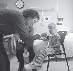 Hanna Carter, 5, of Roanoke, Va., takes a dosage of peanut protein from Nurse Practitioner Pam Steele at the Duke South Clinic at Duke University in Durham, N.C. Hanna is being treated for peanut allergies. A handful of children once severely allergic to peanuts now can eat them without worry. (AP Photo)