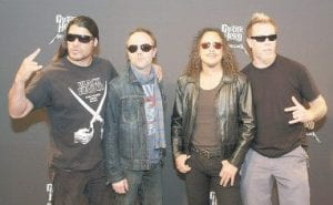 Metallica's Robert Trujillo, Lars Ulrich, Kirk Hammett and James Hetfield were photographed at a news conference in Austin, Texas on March 20 to talk about the new 'Guitar Hero Metallica' videogame. The band gave a SXSW Music Festival performance later in the day. (AP Photo)
