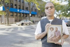 Russell Smith holds a photo of his stepfather, Ivory Jackson, and half-sister, Anita Jackson, outside a nursing home n Chicago. Ivory Jackson, who suffered from Alzheimer's, was killed by his mentally ill roommate after being smashed in the face with a clock radio as he lay in his nursing home bed. (AP Photo)