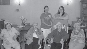 MARKING ST. PATRICK'S DAY — Patients at Letcher Manor celebrated St. Patrick's Day last week but still found time to pose for the camera. Pictured are (left to right, front) Joyce Niece, Irene Houston, Velma Ison, Euna Holbrook, (back) activity director Britanie Sturgill, and activity assistant Christie Boggs.