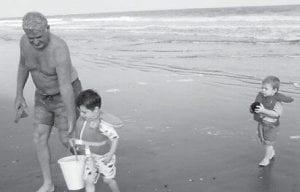 AT THE BEACH —