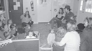 A MOUNTAIN MUSIC LESSON — Preschoolers, toddlers and infants listened and danced while John Wezley Haywood, a musician and teacher with the Early Childhood Program of Traditional Music, played the banjo at Appalachian Early Child Development Center on March 25. The center, located at 356 Circle Drive in Whitesburg, has partnered with Cowan Community Center to form the Early Childhood Program of Traditional Music, a program funded by the Appalachian Regional Commission.