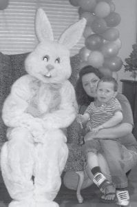 FUND-RAISER — A fund-raiser for the American Cancer Society Relay for Life was held April 5 at Letcher Manor Nursing Home. Visiting children had their picture taken with the Easter Bunny, and nursing home residents helped prepare plastic eggs with goodies inside for the kids. Cookies, punch and gifts were also given to the children. Luke Polly chose the