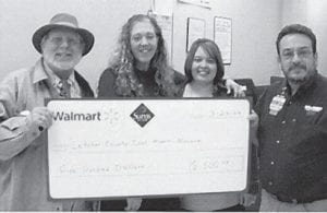 DONATION — Steve Meeks of Whitesburg Wal-Mart (right) presented a check for $500 to the Letcher County Kids Day Committee on March 24. Several Kids Days are being planned throughout Letcher County this year. Also pictured are (left to right) Steve Brewer, Belinda Boggs, and Beth Wright.