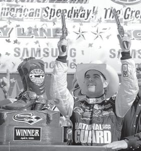 SIX-SHOOTER GORDON — Jeff Gordon celebrated in victory lane with a pair of pistols after winning the NASCAR Samsung 500 auto race at Texas Motor Speedway on Sunday in Fort Worth. (AP Photo)