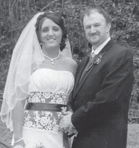 MARRIED — Stephanie Holbrook and Keith Raleigh were married February 14 at the Hemphill Baptist Church. The couple reside in Jenkins and have a daughter, Olivia, 14. She is a medical assistant at the Whitesburg Appalachian Re- gional Hospital Clinic. He works at B.J. Services in Jenkins.