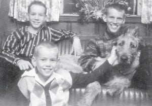 MARLOWE BOYS — Pictured are Bobby, John and Paul Marlowe, sons of the late Betty and Jim Marlowe, and their dog. Whitesburg correspondent Oma Hatton was their babysitter when she was a teenager.