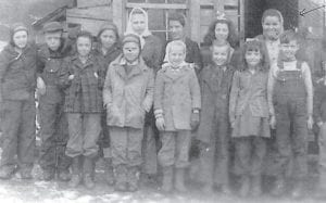 ONE-ROOM SCHOOL — Posing for a photograph are the students of the Pig School, a oneroom school on Cowan. It was sent to Whitesburg correspondent Oma Hatton by Shelby (Thomas) Bockover of Greensburg, Ind., the daughter of Nancy and Culbert Thomas and granddaughter of the late Dan and Polly Thomas of Whitco. She moved to Indiana in 1950, finished high school there, and married Bobby Bockover in 1960. She loves reading The Eagle and goes to the Regular Baptist Church. She gave the names of most of the students including Gay Thomas, Jimmy Caudill, Rollan Trent, Richard Thomas, and the late Nina Thomas (fourth from left, back row), her sister. The next two girls in the back row are Johnsons, and the one on the right is Shelby Bockover. Oma Hatton asks that anyone recognizing the others get in touch with her.