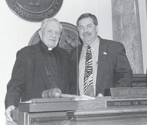 ART LEGACY — The art students of Father Edward Randall are displaying their work at the Harry M. Caudill Memorial Library in Whitesburg. Pictured are Father Randall (left) and former State Representative Howard Cornett.