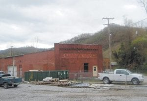 The KYVA Motor Company building is seen in this photo taken Monday. Built in 1934, the building is listed on the National Register of Historic Places. The Whitesburg City Council voted last week to give its approval to a plan to raze the building and replace it with a modern office building. (Photo by Sally Barto)