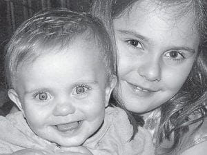 SISTERS — Payton Alexis Cornett turned one year old on April 17. She is pictured with her sister, Korigan, 7. They are the daughters of Robert and Angie Cornett of Neon. Their grandparents are Roger and Anita Yeary of Millstone, and David and Sue Cornett of Jenkins.