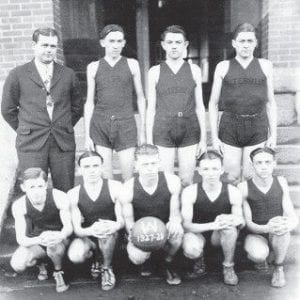 THE BASKETBALL TEAM at Whitesburg High School 1927- 28. Standing (left or right), Coach Marvin Glenn, Blair Adkins, Kelly Ewen, Lincoln Combs. Seated, Olan Cook, Lester Day, Hillard Hall, Woodrow Whitaker and Henry Wright. Cecil Baker is not pictured.