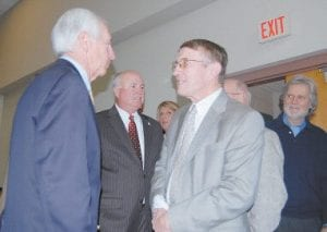 Jenkins Mayor Charles Dixon thanked Gov. Steve Beshear (left) for funding the City of Jenkins will use to replace outdated waterlines. Also shown are State Sen. Johnny Ray Turner (second from left), and Whitesburg architect Bill Richardson, who Beshear identified as a friend. (Eagle photo)