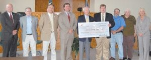 FUNDING FOR DIGITAL RADIOS — Gov. Steve Beshear presented $30,000 to the Letcher Fiscal Court in the Letcher Circuit Courtroom. The State Homeland Security Grant grant will be used to buy radios for police departments and hazardous-materials responders. Pictured from left are State Sen. Johnny Ray Turner, Magistrates Bob Lewis and Archie Banks, Governor's Office for Local Development Commissioner Tony Wilder, Beshear, Letcher Judge/Executive Jim Ward, Letcher County Director of Emergency Management Paul Miles, Magistrate Wayne Fleming and State Rep. Leslie Combs. (Eagle photo)