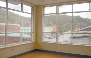 This view from the boardroom overlooks the old Home Lumber Co. property which has been redeveloped into a shopping center/office building, and the old Lewis Wholesale Building now occupied by Whitesburg City Hall. A portion of the old Whitesburg High School campus can also been seen.