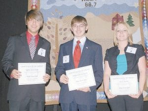 WINNER — Jeffrey Adam Handy (left), a Belfry High School senior representing the Rotary Club of Pikeville, won the regional Rotary Speech Contest hosted by the Rotary Club of Whitesburg at the Appalshop Theater on April 21. Handy also competed in the Rotary District Speech Contest in Pikeville on April 25. Kayla Keeton (right), a senior at Lawrence County High School sponsored by the Rotary Club of Louisa, finished second with Letcher County Central High School junior William Riley Sexton III (center), sponsored by the Rotary Club of Whitesburg, taking third place. (Photo by Becky Johnson for the Rotary Club of Whitesburg)