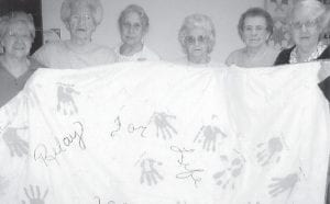 QUILTERS — The quilters at the Ermine Senior Citizens Center made this quilt for the American Cancer Society's Relay for Life. Pictured are Coleen Hart, Dorothy York, Vina Lucas, Margaret Pease, Evelyn Caudill, and Joy Pease. Not pictured is Judy Hampton.