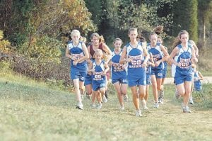 Jill Collier, second from left, is seen with other members of the Pulaski Southwestern High School cross-country team. Her father, Jeff Collier, starred in cross-country at Whitesburg High School. (Photo by Steve Cornelius)
