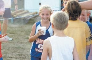 Jill Collier was all smiles as she took a break from running. She is a granddaugther of Wanda Collier of Partridge and the late Roger Collier, Millie Quillen of Somerset, and Ernie Huff of Somerset. (Photo by Steve Cornelius)