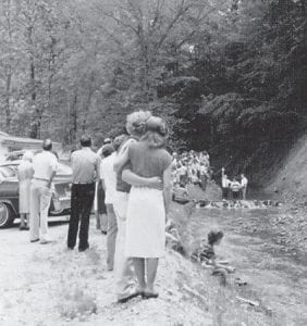 Pictured are church members attending a baptism.