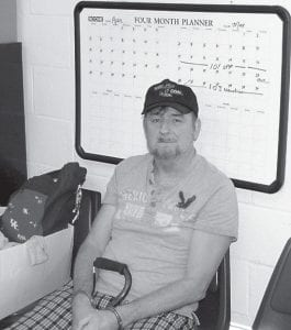 Larry Wayne Sergent, 52, of Flat Gap sat in the Letcher County Sheriff's Office Tuesday after being charged with conspiracy to distribute oxycodone, conspiracy to launder money, and distribution of oxycodone.