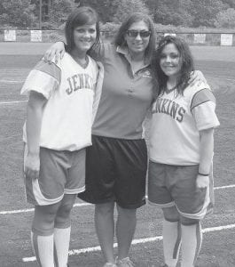 Seniors Whitney Gibson and Rachel Thacker with coach April Charles on Senior Day. (Photo by Cynthia Damron)