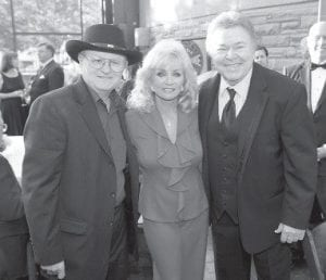 Country music stars (from left) Charlie McCoy, Barbara Mandrell and Roy Clark posed before being inducted into the Country Music Hall of Fame in Nashville on Sunday. (AP Photo)